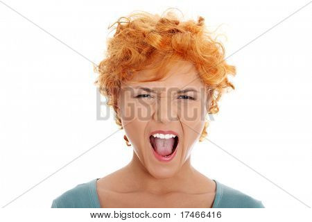 Furiouse young redhead woman screaming. Isolated on white