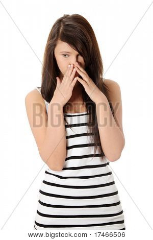 Young teen woman with depression isolated on white