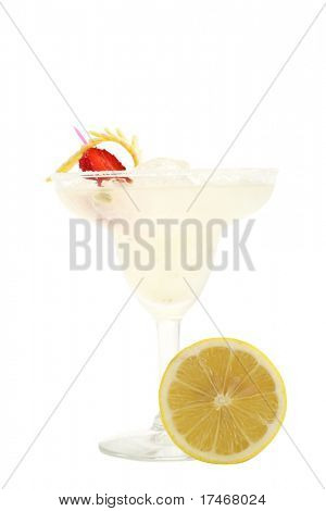 Refreshment Acoholic Drink made of Tequila, Lemon Juice, and Liqueur. Served with salt on the glass rim. Lemon and Strawberry Garnish. Isolated on White Background.