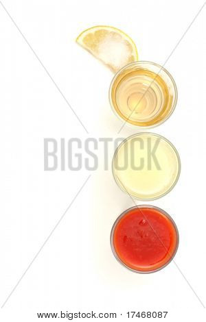 Tequila, Lemon Fresh, Tomato Fresh and Salt on Slice of Lemon. Isolated on White Background.