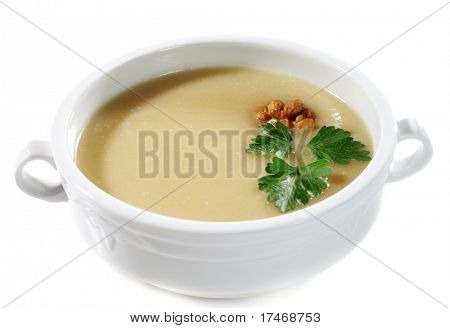 Onion Cream Soup Dressed with Circassian Walnut and Parsley Leaves. Isolated on White Background