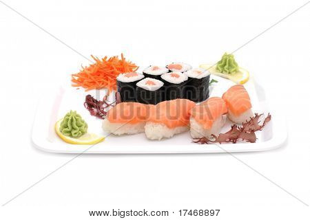 Set of sushi and rolls with a salmon.