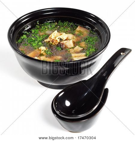 Japanese Soup with Crab Meat in Black Dish. Isolated on White Background