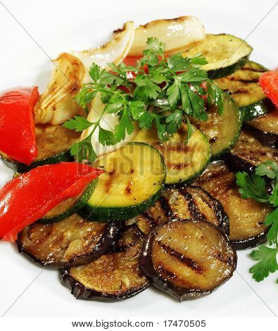 Grilled Vegetables Plate Served with Parsley and Fresh Red Pepper. Isolated on White Background