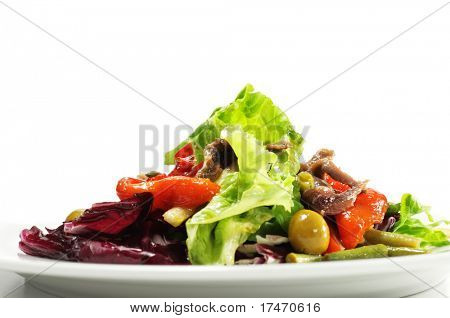 Salad with Anchovy, Olive and Vegetable Leaf. Isolated on White Background