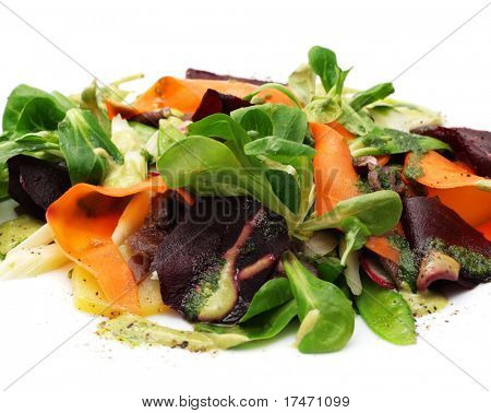 Salad from Vegetables and Roe Meat over White Background