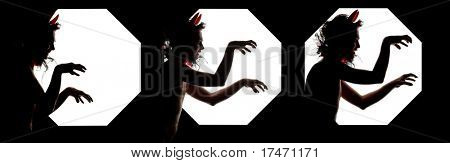 Silhouette of Steal Up Devil with Red Horns. Isolated on Black Background