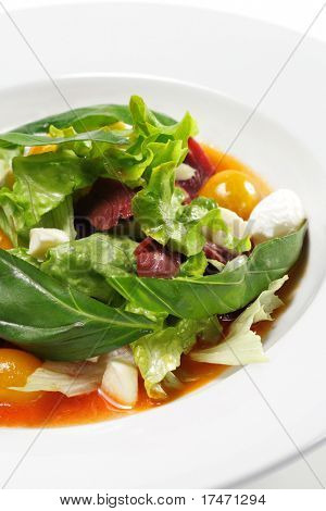Salad - Smoked Magret (Duck Breast) with Red Chaud-Froid Sauce. Comprises Tomato and Vegetable Leaf