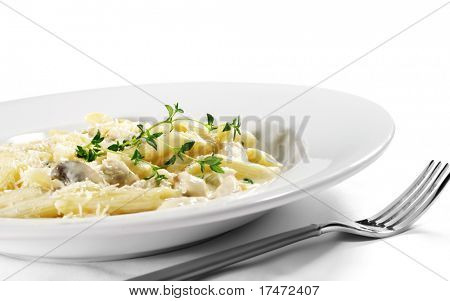 Pasta Penne with Chicken and Mushroom under Parmesan Cheese. Isolated on White Background