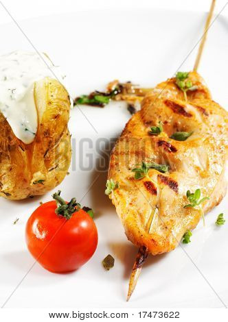Chicken Breasts Shish Kebab Served with Roast Potatoes and Cherry Tomato. Isolated on White Background
