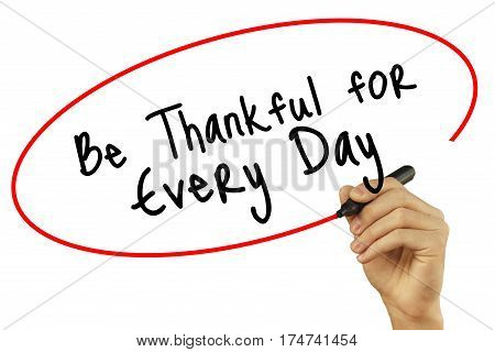 Man Hand Writing Be Thankful For Every Day With Black Marker On Visual Screen. Isolated On White Bac