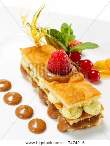 Dessert - Sponge Cake with Chocolate and Pistachio Mousse and Fresh Berries