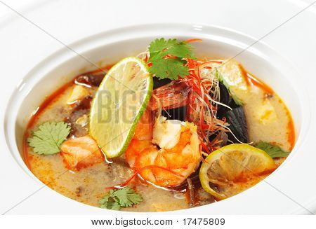 Thai Dishes - Tom Yam Kung. Spicy Shrimp Soup with Coconut milk, Lime and Seafood