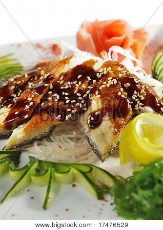 Unagi Sashimi - Smoked Eel on Daikon (White Radish) with Eel Sauce and Sesame. Served with Seaweed, Cucumber and Lemon