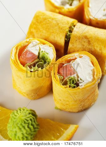 Mexico Maki Sushi - Roll made of Smoked Salmon, Cream Cheese and Salad Leaf inside. Mexican Pancake ouside