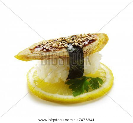 Japanese Cuisine -  Egg (tamago yaki - japanese omelet) Nigiri Sushi. Topped with Eel Sauce and Sesame. Served on Lemon Slice