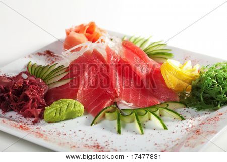Tuna Sashimi - Sliced Raw Tuna on Daikon (White Radish) with Seaweed and Cucumber