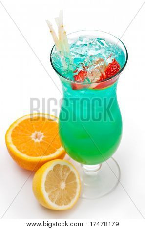 Tropical Alcoholic Drink Made of Rum, Pineapple Juice, Blue Curacao, Sweet and Sour Mix. Slice of Apple and Strawberry as a Garnish.