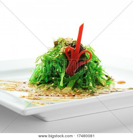 Pickled Seaweed with Nut Sauce. Garnished with Sesame Seeds and Red Pepper