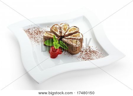 Tiramisu Sushi Roll garnished with Strawberry and Mint