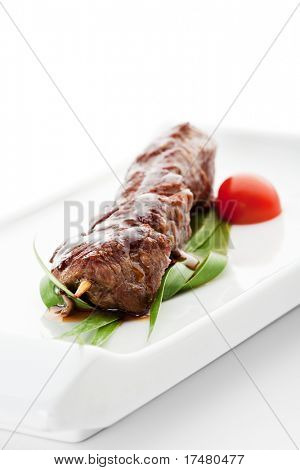 Grilled Veal Meat  Garnished with Cherry Tomato and Green Leaf
