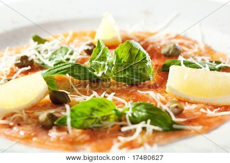Appetizer - Salmon Carpaccio with Parmesan Cheese, Herbs and Lemon Slice