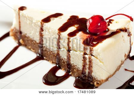 Cheesecake with Chocolate Sauce and Cherries