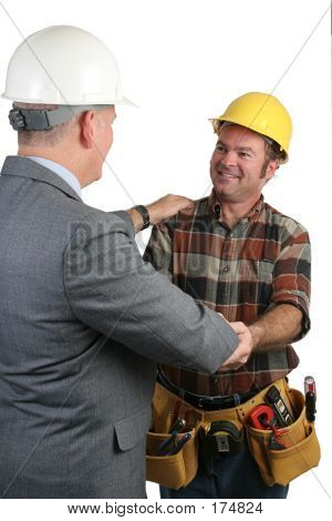 Supervisor Congratulating Tradesman