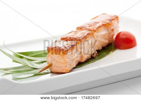 Grilled Salmon  Garnished with Cherry Tomato and Green Leaf