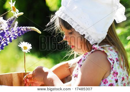 Cute girl with a daisy