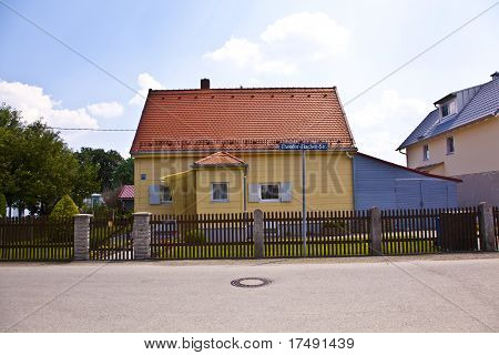 old house in a typical housing area in a suburban street in Munich