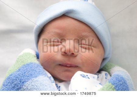 Newborn Wrapped In Blue