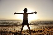 stock photo of children beach  - Silhouette of child on the beach - JPG