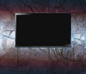 stock photo of high-def  - Flat screen on a wall - JPG