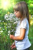 picture of may-flower  - Little girl on meadow with wild flower - JPG