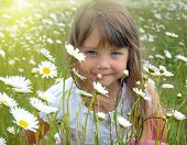 stock photo of flower girl  - Hiding behind the flowers - JPG