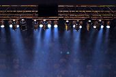 stock photo of stage theater  - Stage lights and audience in background - JPG