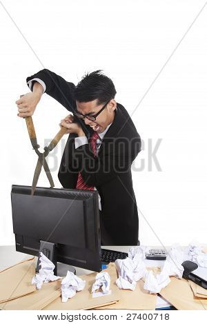 Mad Businessman With Grass Shear In His Office