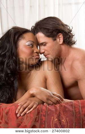Interracial Lovers - sensual heterosexual couple making love. African-American black woman and Caucasian man
