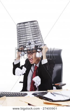 Angry Businessman With Rubbish Bin On His Head