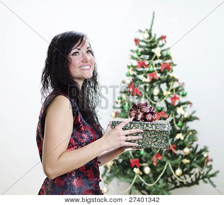 Christmas: Smiling Brunette Girl With Gift
