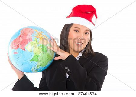 Asian Businesswoman With Santa Hat And Globe