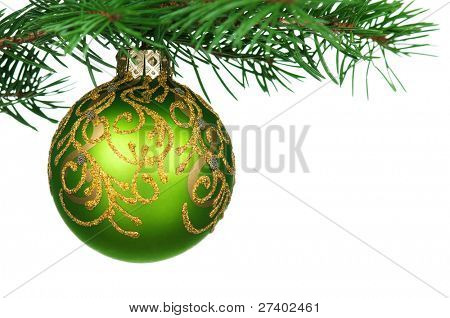 Small bauble on green christmas firtree on white background