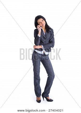 Business woman talking on her mobile phone isolated on white background