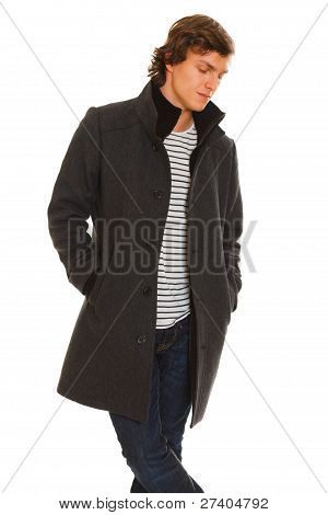 Portrait Of Thoughtful Young Man In Winter Coat