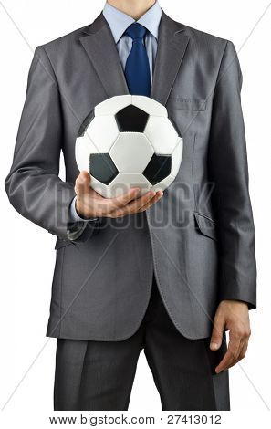 Businessman holding football on white