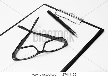 Blank clipboard with pen and eyeglasses, on white background