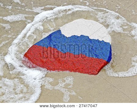 Flag Of  Russia On A Stone On The Beach Of The Baltic Sea
