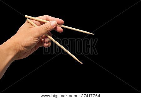 Hand and bamboo chopsticks