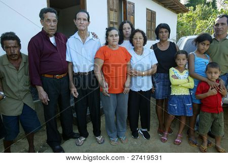 GONZAGA, BRAZIL - JULY 26:  Matozinhos Otoni da Silva (3rd-L) and his wife, Maria Otoni de Menezes (4th-L) stand with relatives and friends outside their family home July 26, 2005 in Gonzaga, Brazil.